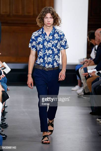 A model walks the runway during the Officine Generale Menswear Spring/Summer 2017 show designed by Pierre Mahéo as part of Paris Fashion Week on June...