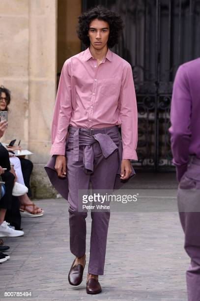 A model walks the runway during the Officine Generale Menswear Spring/Summer 2018 show as part of Paris Fashion Week on June 25 2017 in Paris France