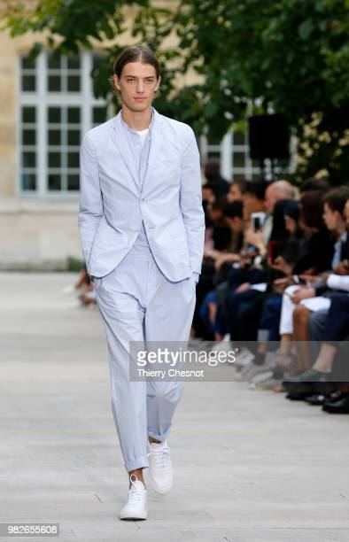A model walks the runway during the Officine Generale Menswear Spring/Summer 2019 show as part of Paris Fashion Week on June 24 2018 in Paris France