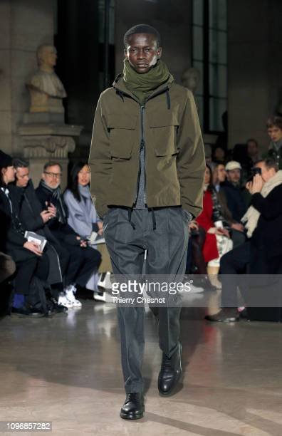 A model walks the runway during the Officine Generale Menswear Fall/Winter 20192020 show as part of Paris Fashion Week on January 20 2019 in Paris...