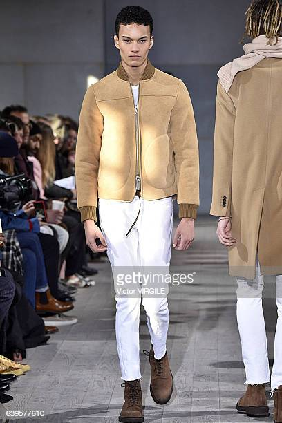 A model walks the runway during the Officine Generale Menswear Fall/Winter 20172018 show as part of Paris Fashion Week on January 22 2017 in Paris...