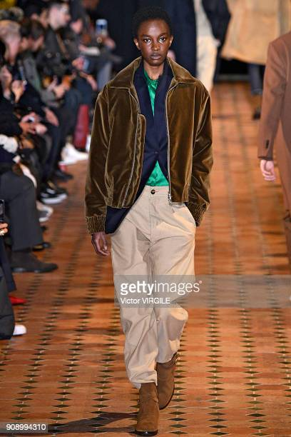 A model walks the runway during the Officine Generale Menswear Fall/Winter 20182019 show as part of Paris Fashion Week on January 21 2018 in Paris...