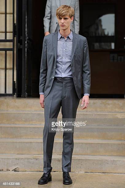 A model walks the runway during the Officine Generale show as part of Paris Fashion Week Menswear Spring/Summer 2015 on June 29 2014 in Paris France