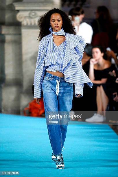 A model walks the runway during the OffWhite designed by Virgil Abloh show as part of the Paris Fashion Week Womenswear Spring/Summer 2017 on...