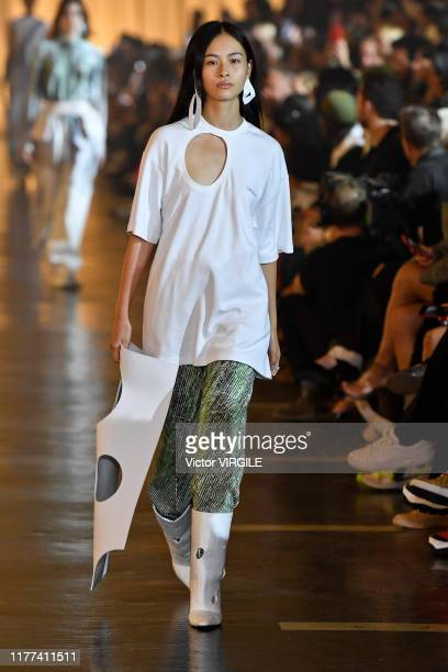 Model walks the runway during the Off-White Ready to Wear Spring/Summer 2020 fashion show as part of Paris Fashion Week on September 26, 2019 in...