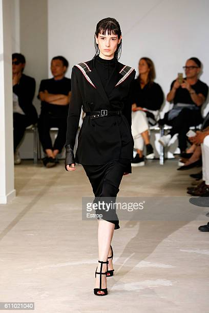Model walks the runway during the Olivier Theysen show as part of the Paris Fashion Week Womenswear Spring/Summer 2017 on September 27, 2016 in...