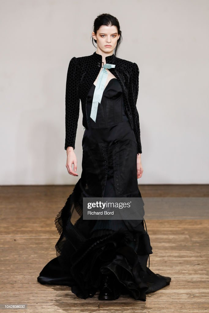 model-walks-the-runway-during-the-olivier-theyskens-show-as-part-of-picture-id1042638032