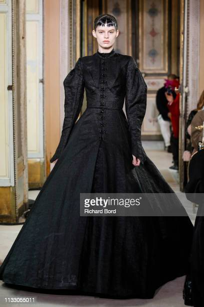 Model walks the runway during the Olivier Theyskens show as part of the Paris Fashion Week Womenswear Fall/Winter 2019/2020 on March 01, 2019 in...