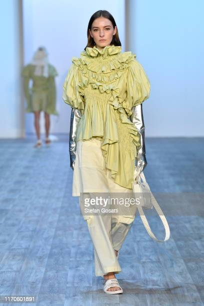 A model walks the runway during the Olli Collections show during New Zealand Fashion Week 2019 at Auckland Town Hall on August 28 2019 in Auckland...
