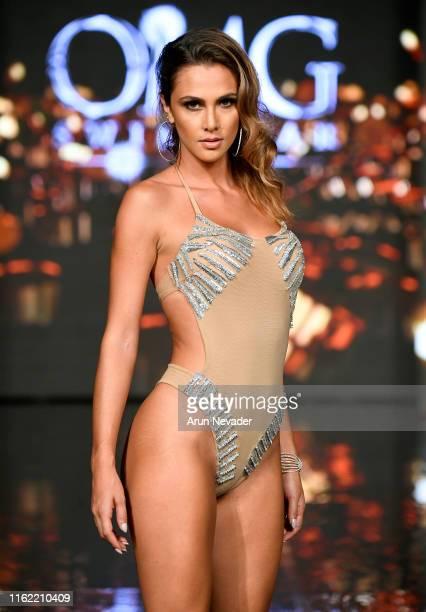 Model walks the runway during the OMG SWIMWEAR show At Miami Swim Week Powered By Art Hearts Fashion Swim/Resort 2019/20 at Faena Forum on July 13,...
