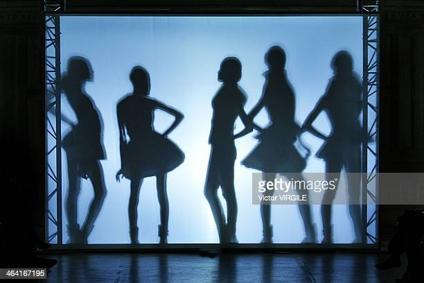 A model walks the runway during the On Aura Tout Vu show as part of Paris Fashion Week Haute Couture Spring/Summer 2014 on January 20 2014 in Paris...
