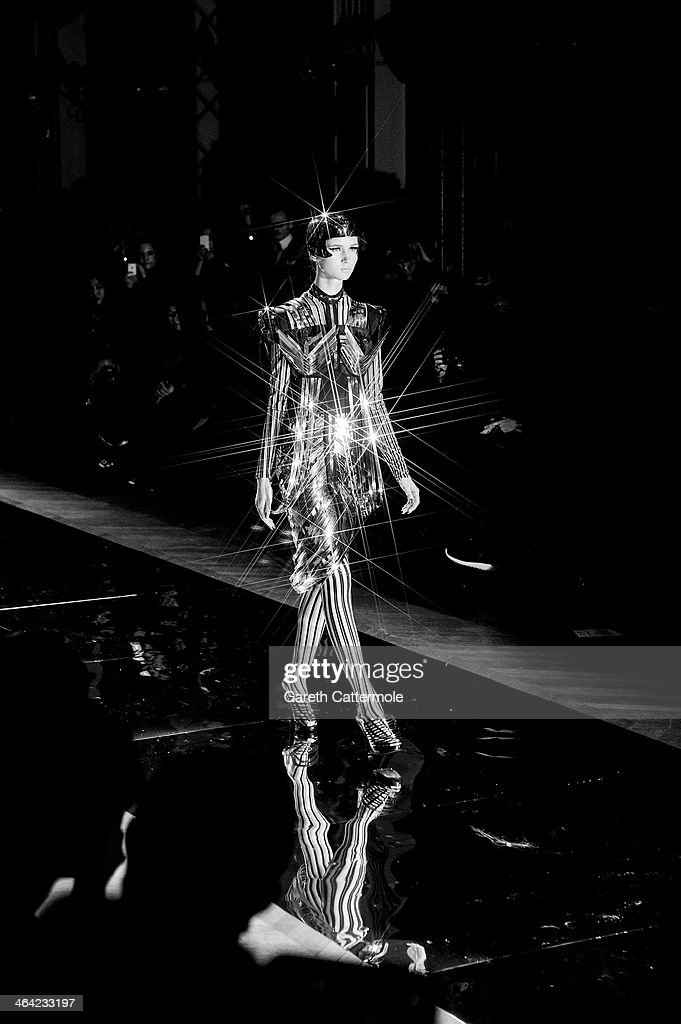 A model walks the runway during the Oscar Carvallo show as part of Paris Fashion Week Haute-Couture Spring/Summer 2014 at Mairie du 4e on January 21, 2014 in Paris, France.