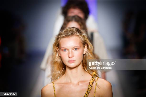 A model walks the runway during the Osklen fashion show during Sao Paulo Fashion Week N46 Winter 2019 at Arca on October 22 2018 in Sao Paulo Brazil