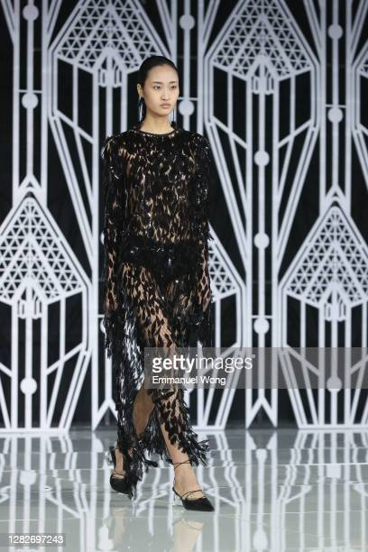 A model walks the runway during the OU collection show by Chinese designer Xu Hua on day five of China Fashion Week at 751DPARK on October 28 2020 in...