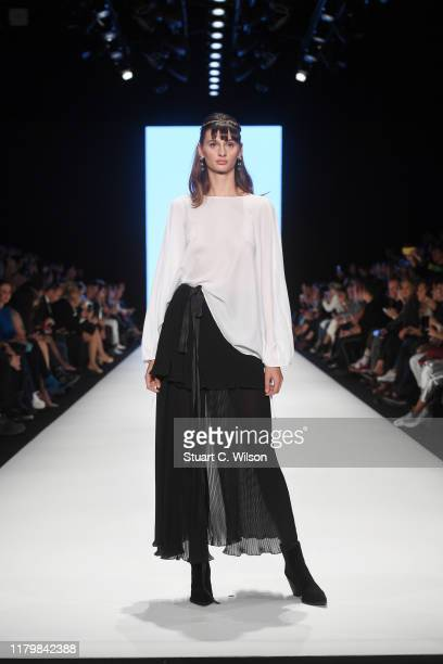 A model walks the runway during the Ozlem Suer show during MercedesBenz Istanbul Fashion Week at Zorlu Performance Hall on October 08 2019 in...
