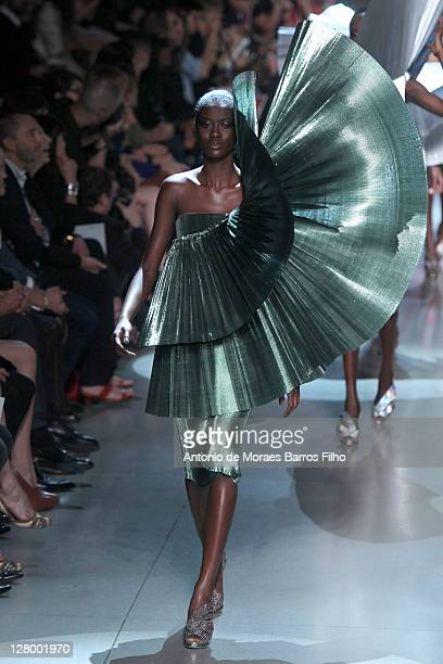 Model walks the runway during the Paco Rabanne Ready to Wear Spring / Summer 2012 show during Paris Fashion Week on October 4, 2011 in Paris, France.