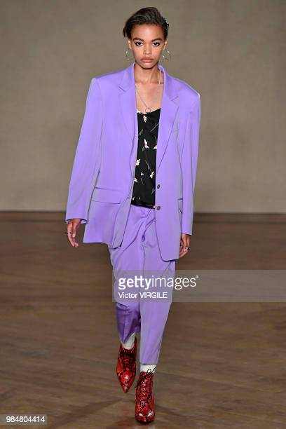A model walks the runway during the Paul Smith Menswear Spring/Summer 2019 fashion show as part of Paris Fashion Week on June 24 2018 in Paris France