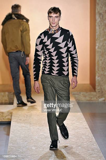 Model walks the runway during the Paul Smith Ready to Wear Fall/Winter 2013-2014 show as part of Paris Fashion Week on January 20, 2013 in Paris,...