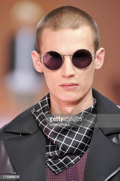 Model walks the runway during the Paul Smith Ready to Wear Menswear Spring/Summer 2014 show as part of the Paris Fashion Week on June 30, 2013 in...