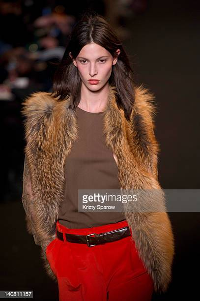 Model walks the runway during the Paul&Joe Ready-To-Wear Fall/Winter 2013 show as part of Paris Fashion Week at Espace Cambon Capucines on March 6,...