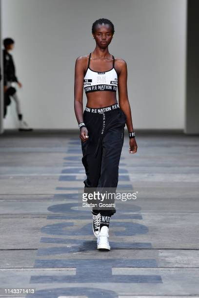 Model walks the runway during the P.E Nation show at Mercedes-Benz Fashion Week Resort 20 Collections at Carriageworks on May 13, 2019 in Sydney,...
