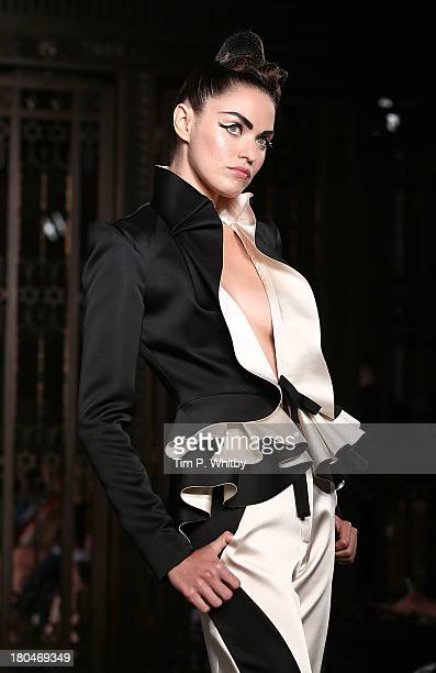 A model walks the runway during the Pearce Fionda show at London Fashion Week SS14 at Freemasons Hall on September 13 2013 in London England