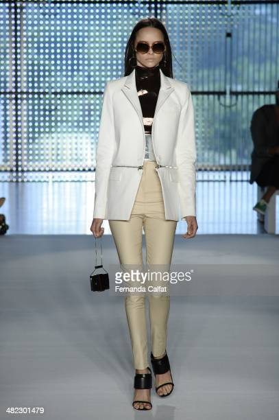 A model walks the runway during the Pedro Lourenco show at Sao Paulo Fashion Week Summer 2014/2015 at Parque Candido Portinari on April 3 2014 in Sao...