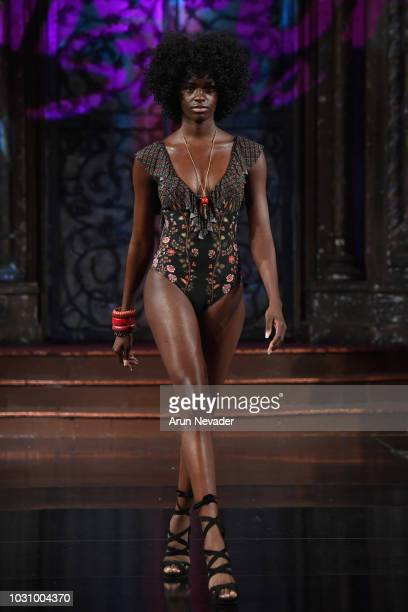 A model walks the runway during the PIN UP STARS show at New York Fashion Week Powered By Art Hearts Fashion at The Angel Orensanz Foundation on...