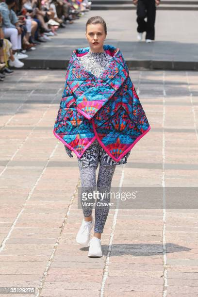 A model walks the runway during the Pineda Covalin fashion show as part of the MercedesBenz Fashion Week Mexico Fall/Winter 2019 Day 5 at Bosque de...