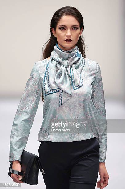 A model walks the runway during the Pineda Covalin Show as part of MercedesBenz Fashion Week Mexico Fall/Winter 2015 day 1 at Campo Marte on April 14...