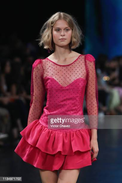 A model walks the runway during the Pink Magnolia fashion show as part of the MercedesBenz Fashion Week Mexico Fall/Winter 2019 Day 4 at Fronton...