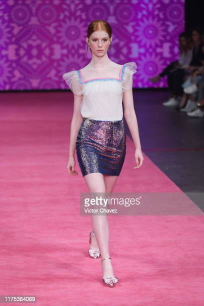 A model walks the runway during the Pink Magnolia show as part of the MercedezBenz Fashion Week Mexico Spring/Summer 2020 Day 5 at Fronton Mexico on...