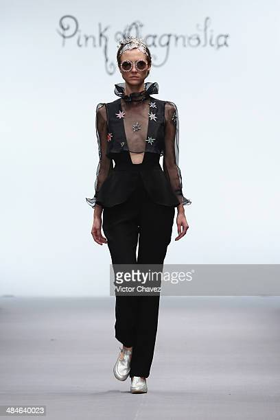 A model walks the runway during the Pink Magnolia show at MercedesBenz Fashion Week Mexico Autumn/Winter 2014 at Campo Marte on April 4 2014 in...