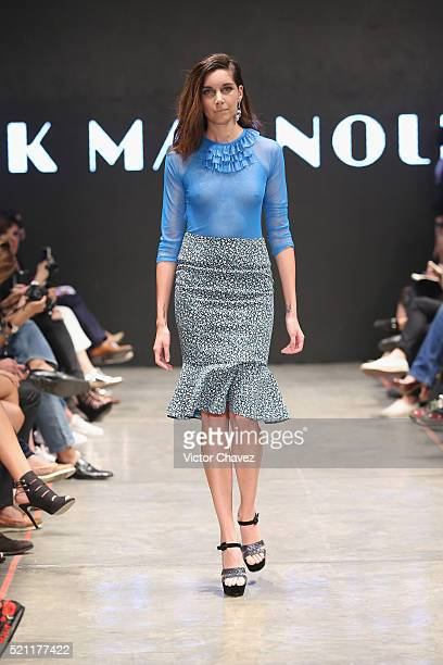 A model walks the runway during the Pink Magnolia show at MercedesBenz Fashion Week Mexico Autumn/Winter 2016 at Auditorio BlackBerry on April 13...