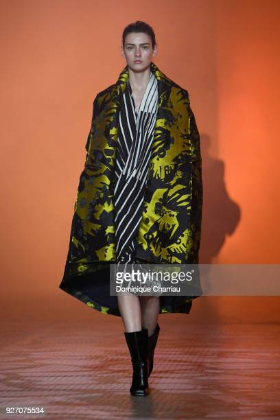 A model walks the runway during the Poiret show as part of the Paris Fashion Week Womenswear Fall/Winter 2018/2019 on March 4 2018 in Paris France