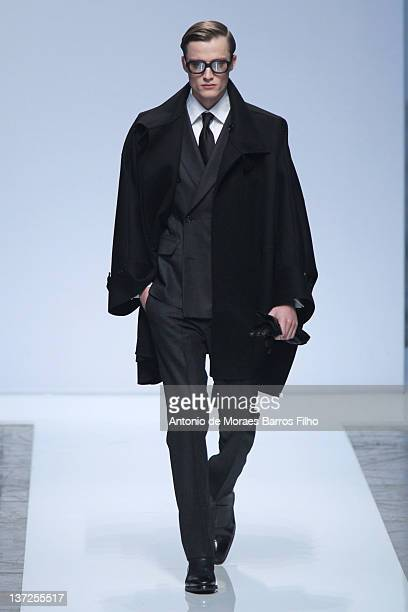 Model walks the runway during the Ports 1961 fashion show as part of Milan Fashion Week Menswear Autumn/Winter 2012 on January 17, 2012 in Milan,...