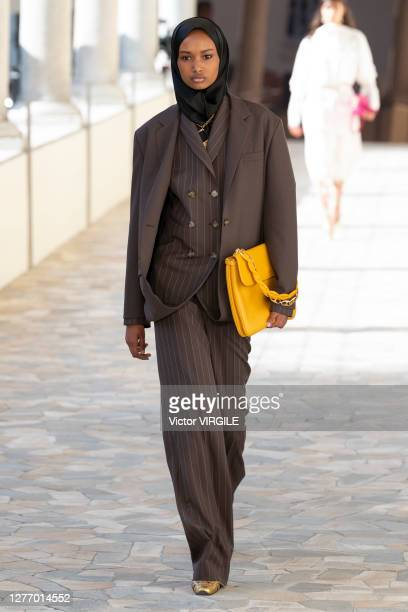 Model walks the runway during the Ports 1961 Ready to Wear Spring/Summer 2012 fashion show during Milan Women's Fashion Week Spring/Summer 2021 on...