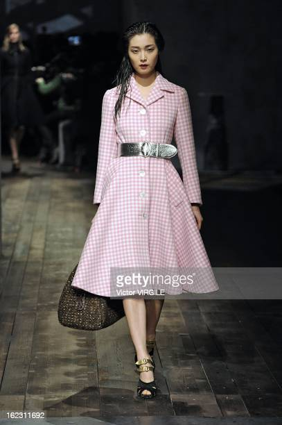 Model walks the runway during the Prada Ready to Wear Fall/Winter 2013-2014 show as part of the Milan Fashion Week Womenswear Fall/Winter 2013/14 on...
