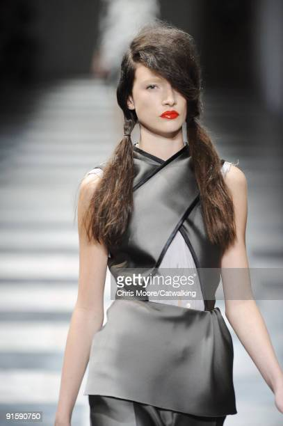 A model walks the runway during the Prada Spring Summer 2010 Ready To Wear show as part of the Milan Womenswear Fashion Week Spring/Summer 2010 at...