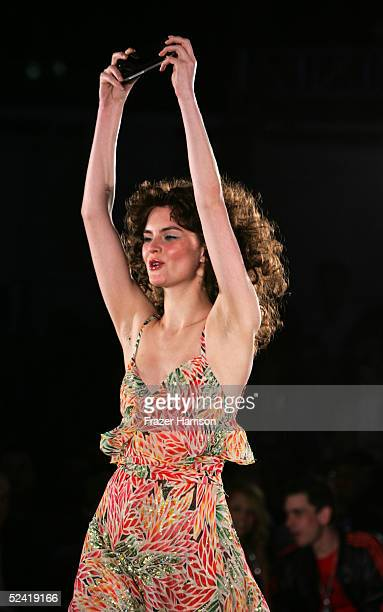 A model walks the runway during the Pret A PSP fashion show to celebrate the launch of the PlayStation handheld entertainment system at the Pacific...