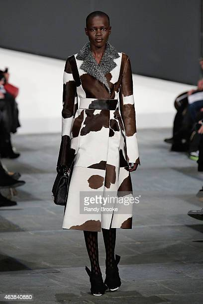 A model walks the runway during the Proenza Schouler Runway show at the MercedesBenz Fashion Week Fall 2015 at Marcel Breuer Building on February 18...