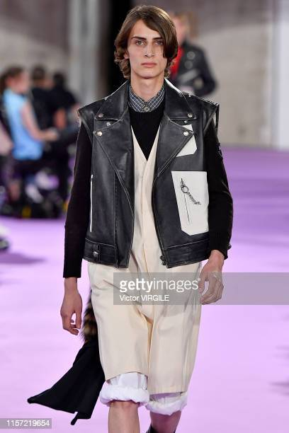 Model walks the runway during the Raf Simons Menswear Spring Summer 2020 show as part of Paris Fashion Week on June 19, 2019 in Paris, France.