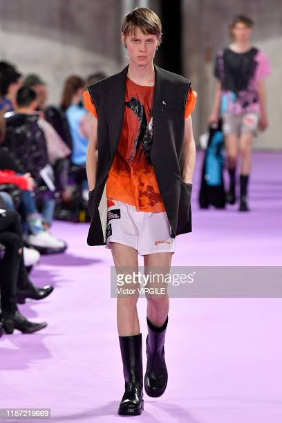 A model walks the runway during the Raf Simons Menswear Spring Summer 2020 show as part of Paris Fashion Week on June 19 2019 in Paris France
