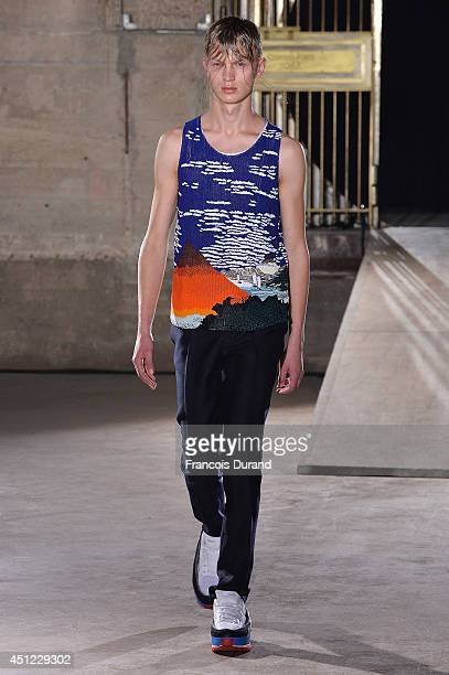 A model walks the runway during the Raf Simons show as part of the Paris Fashion Week Menswear Spring/Summer 2015 on June 25 2014 in Paris France