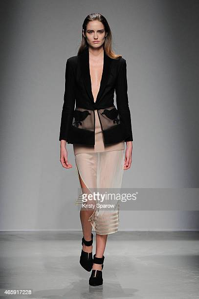 A model walks the runway during the Rahul Mishra show as part of Paris Fashion Week Womenswear Fall/Winter 2015/2016 at Palais de Tokyo on March 11...