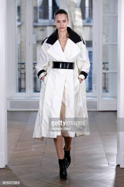 A model walks the runway during the Ralph Russo Presentation as part of the Paris Fashion Week Womenswear Fall/Winter 2018/2019 on February 28 2018...