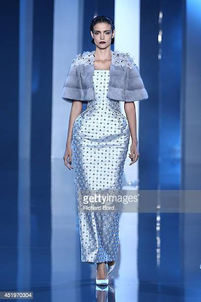 A model walks the runway during the Ralph Russo show as part of Paris Fashion Week Haute Couture Fall/Winter 20142015 at Pavillon Cambon Capucines on...