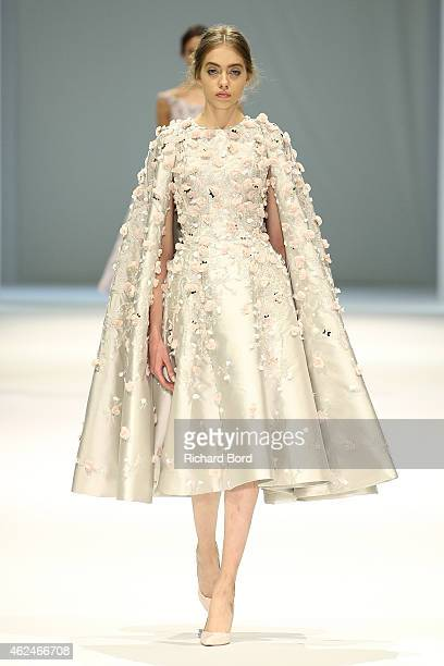 A model walks the runway during the Ralph Russo show as part of Paris Fashion Week Haute Couture Spring/Summer 2015 on January 29 2015 in Paris France