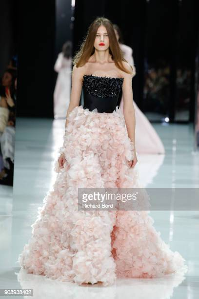 A model walks the runway during the Ralph Russo Spring Summer 2018 show as part of Paris Fashion Week on January 22 2018 in Paris France