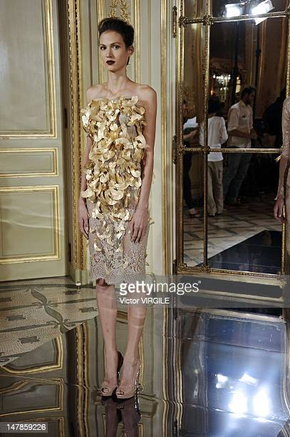 A model walks the runway during the Rami Al Ali Haute Couture Fall Winter 20122013 show as part of the Paris Haute couture Week on July 4 2012 in...